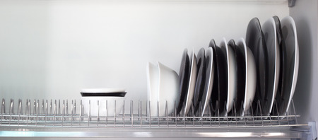kitchen furniture: Detail of open kitchen drawers with dishes. Stock Photo