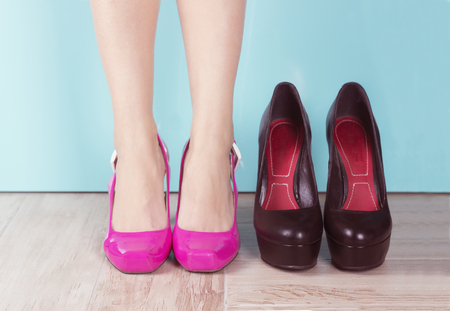 Hard choice. Woman deciding what shoes to choose Stock Photo