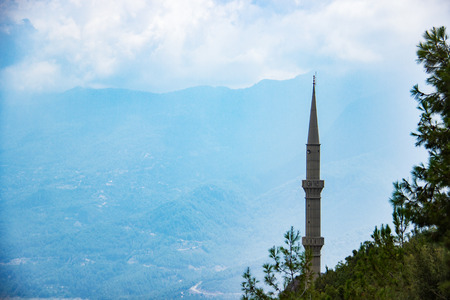 Mosque in a cornfield on a background of mountains. Turkey, Alanya