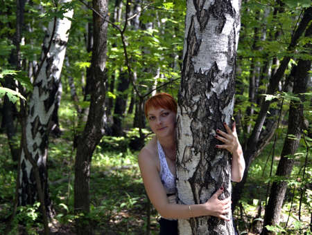 The girl at a birch Stock Photo - 13854628