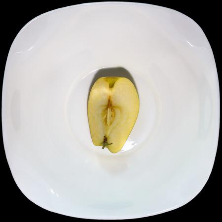 quartered: apple quartered on a white plate Stock Photo