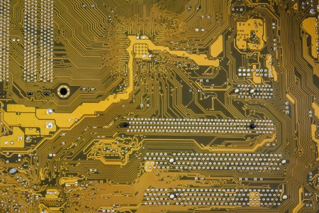 Yellow-brown printed circuit board texture background.