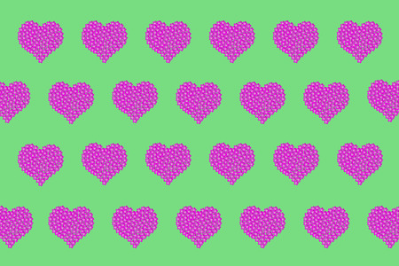 Pattern of hearts of flowers of pink color on a green background 스톡 콘텐츠