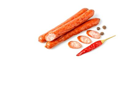 Juicy pork sausages with allspice and red chili pepper, top view on a white background, copy space Standard-Bild - 136483395