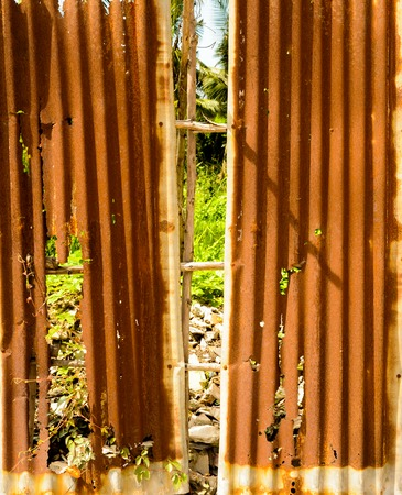 Old rusty of zinc sheet  fence is grunge  background.