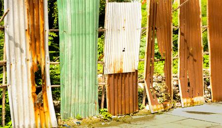 oxidation: Old rusty of zinc sheet  fence is grunge  background.