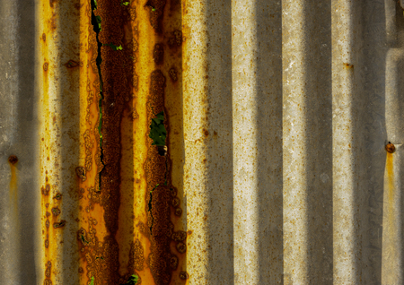 corrode: Old rusty of zinc sheet  fence is grunge  background.