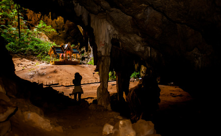 faraway: Beautiful stone Cave with above light in Thailand. Stock Photo