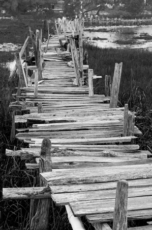 long lake: Old wooden  long  bridge cross the lake.
