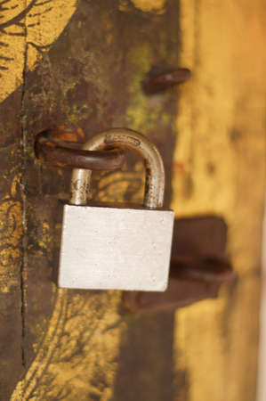 Old padlock on a wooden door  photo
