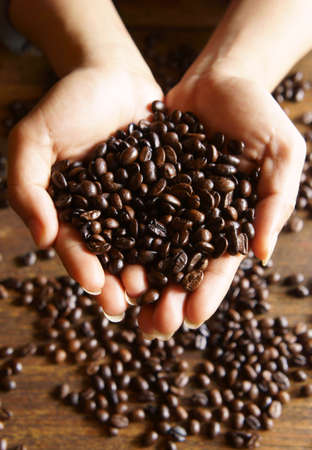 coffee beans in hand Stock Photo