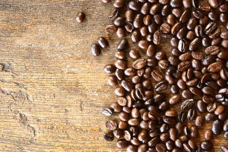 coffeetree: Fresh coffee beans on wood background