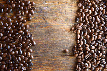 Coffee beans on vintage wooden board photo