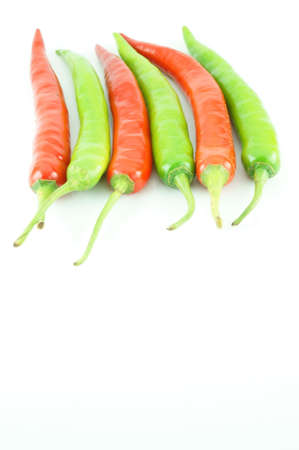 red hot chili and green chili on white background