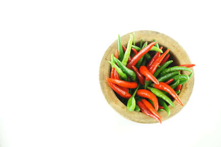 Thai Chili Style with wooden mortar with white background Stock Photo