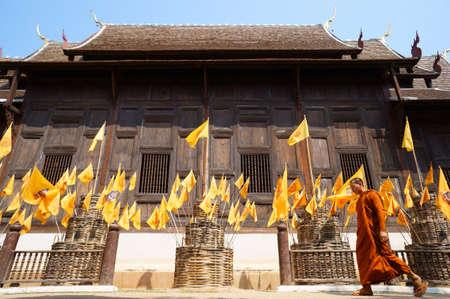 Buddhist monk walking in Phan-Tao temple, Chiangmai - Thailand  Editorial