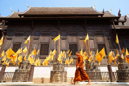 Buddhist monk walking in Phan-Tao temple, Chiangmai - Thailand