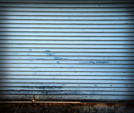 Illuminated grunge metallic roller shutter door