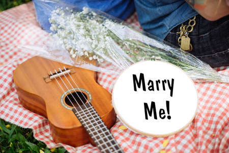 Will you marry me ? Young couple spending weekend together with guitar Stock Photo