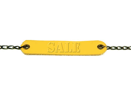 Wording sale. Light brown leather name tag with chain on white background. Stock Photo