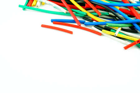 Network chaos of colorful cables on white background. Stock Photo