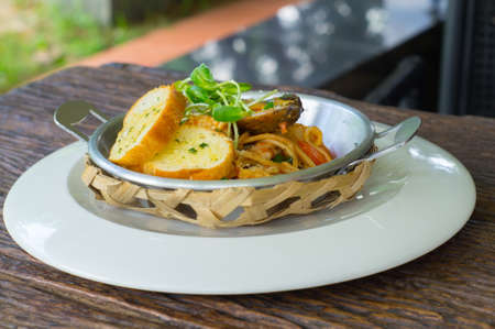 Spaghetti with garlic bread.