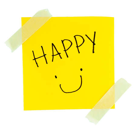 Smiley Face yellow sticky note with masking tape on white background Stock Photo