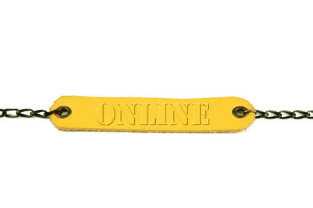 Wording online. Light brown leather name tag with chain on white background.