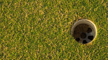 Golf hole on the green grass. Stock Photo