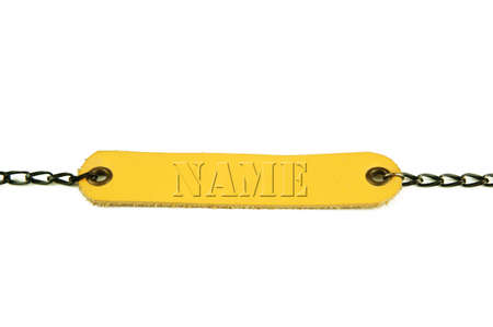 Wording name. Light brown leather name tag with chain on white background.