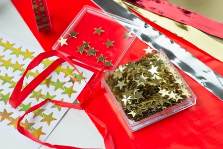 Christmas decoration with stars  paper, table stars, stickers, masking tape, bands
