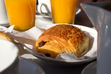 Classic french breakfast with hot chocolate, chocolate croissant and fresh juice photo