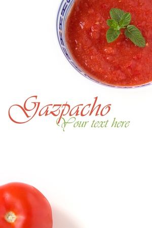 Red gazpacho made with tomatoes, papers and curry decorated with mint. Stock Photo