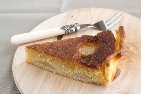 Traditional french Bourdaloue pie: a pie with almond marzipan cream and pears.