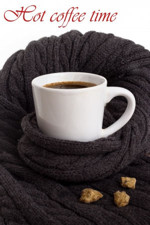 serenety: A white cup of  coffee on the background ofthe grey scraf. White background is suitable for additional notes.