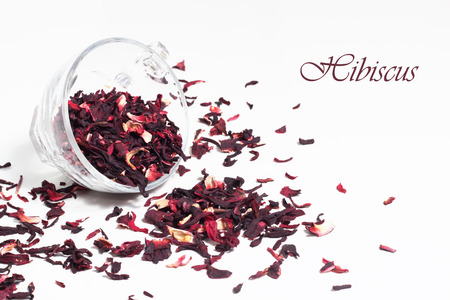 Isolated dry hibiscus in transparent tea cup isolated on white background. Stock Photo