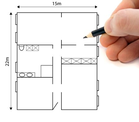 architect drawing: A hand drawing a ground plan to plan a building project.