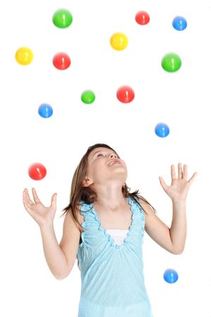 A young girl catching colored balls. All isolated on white background Stock Photo - 6265172