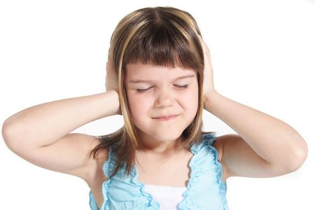 A young girl suffering from noise. All isolated on white background. Stock Photo