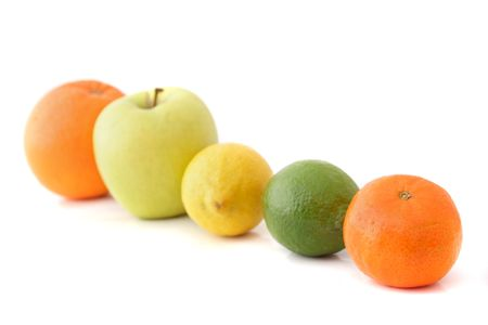 vitamines: A line of various fruits. All isolated on white background. ** Note: Shallow depth of field. Stock Photo