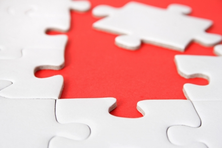 conceptions: A jigsaw puzzle with a red gap. Stock Photo