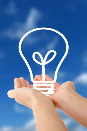 notion: Human hands holding a stylized bulb in front of a bright blue sky.