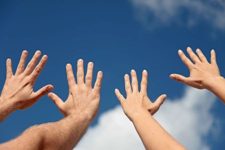 Two persons lifting their hands up in the air. photo