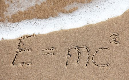 coefficient: Writings in the sand on the beach symbolizing school vacation.
