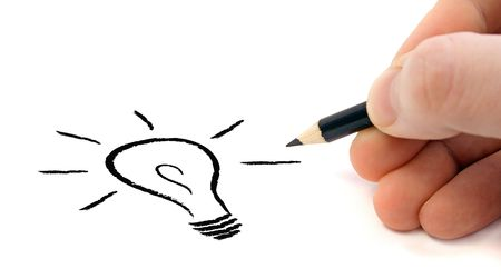 A human hand sketching a stylized light bulb. All on white background.