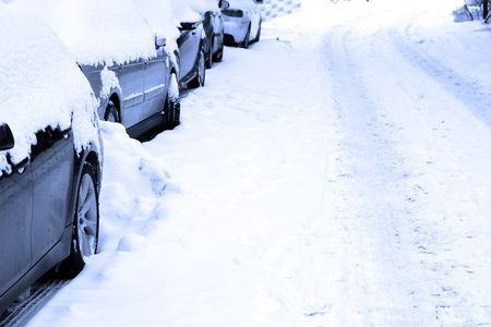 snow capped: Several cars parking on a snowbound street. Stock Photo