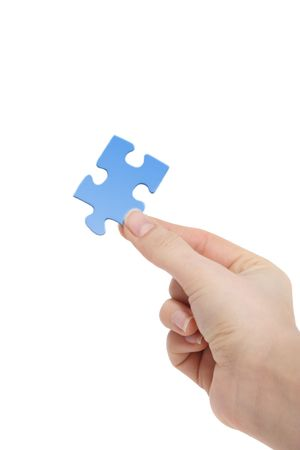 conceptions: A person holding a blue piece of a puzzle in his hand. All on white background. Stock Photo