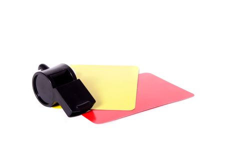 arbiter: A yellow and red card lying next to a whistle. All isolated on white background. Stock Photo