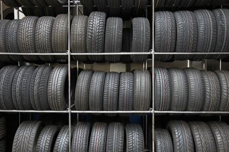 tire repair shop: A rack full of tires in a tire workshop. Stock Photo