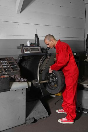 mechanist: A working mechanist in a tire workshop. Stock Photo